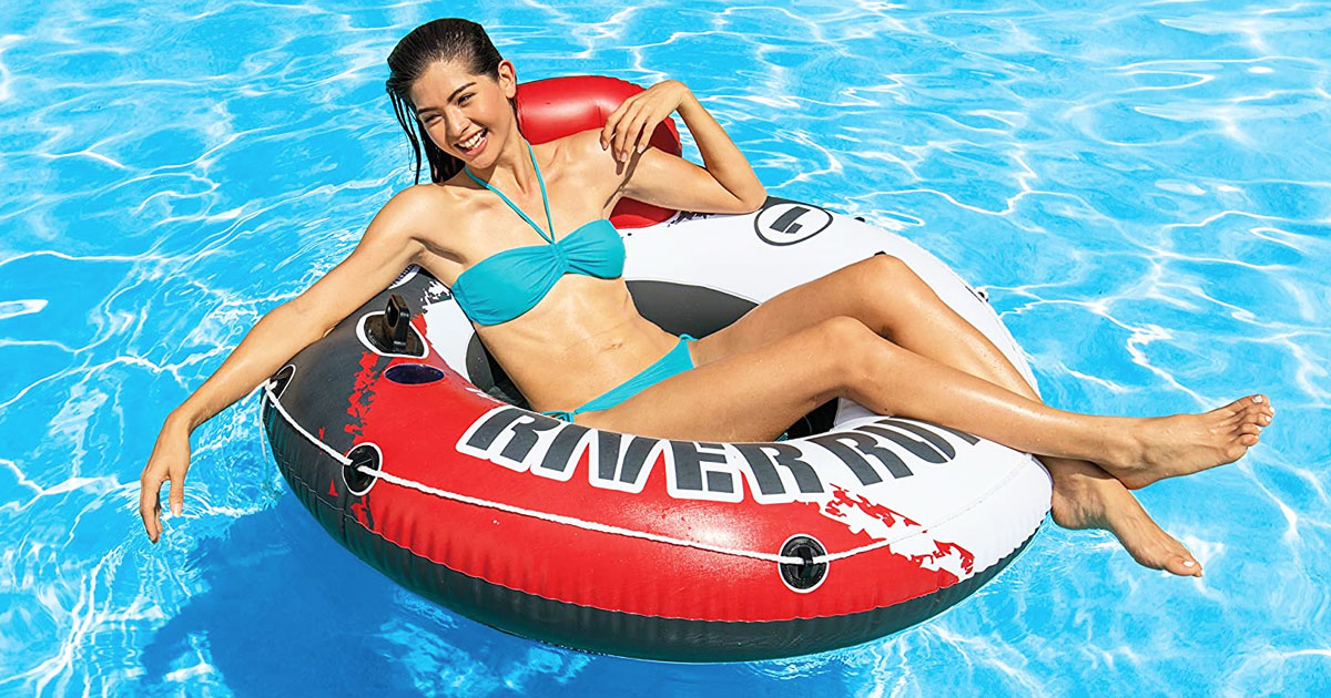 woman in round pool float in swimming pool