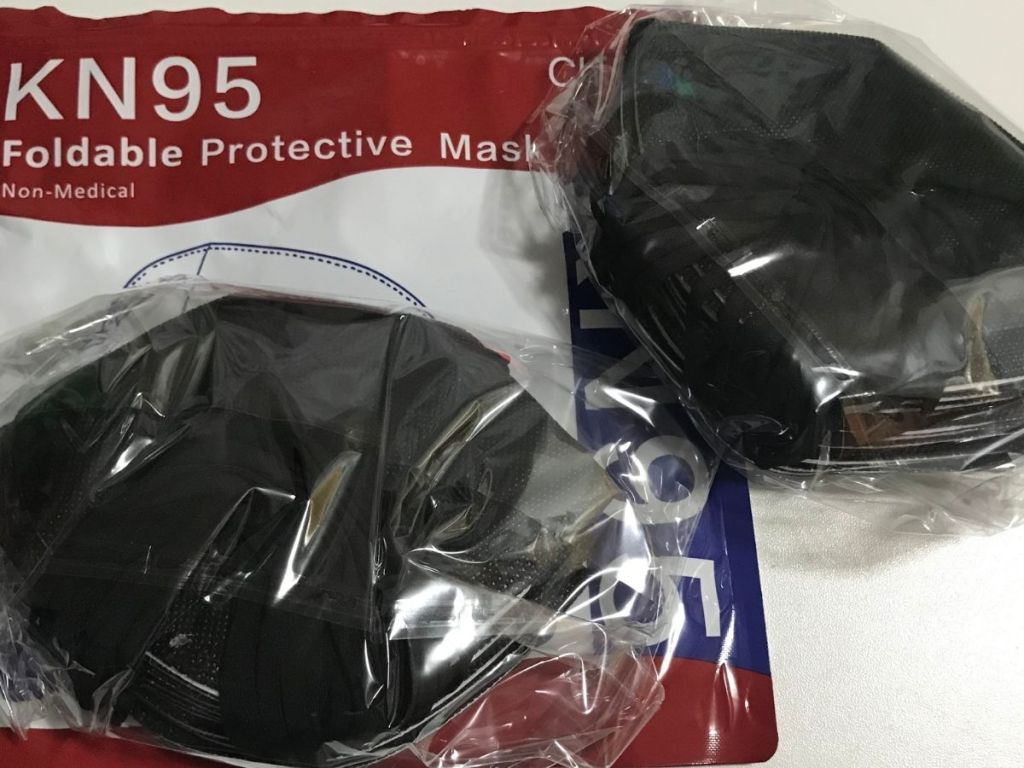 KN95 mask package with black masks individually wrapped