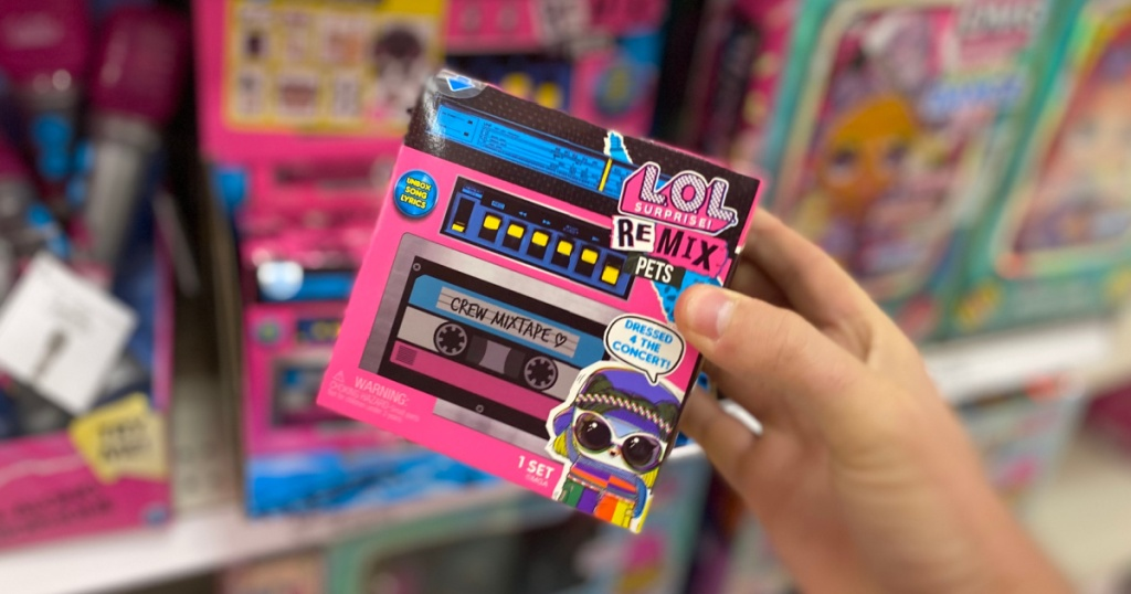 hand holding cassette tape toy box