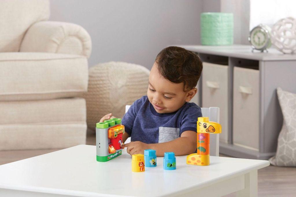 Boy playing Safari Animals LeapFrog Blocks