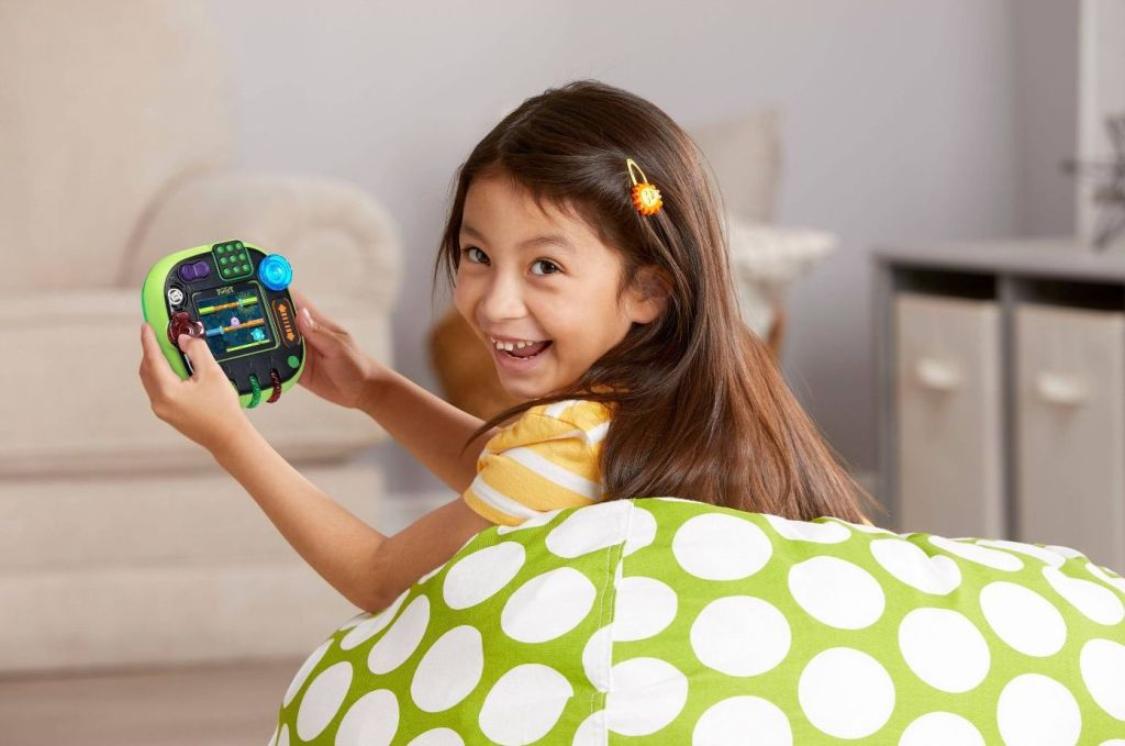 girl playing LeapFrog Rockit