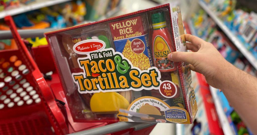 hand holding play taco food set