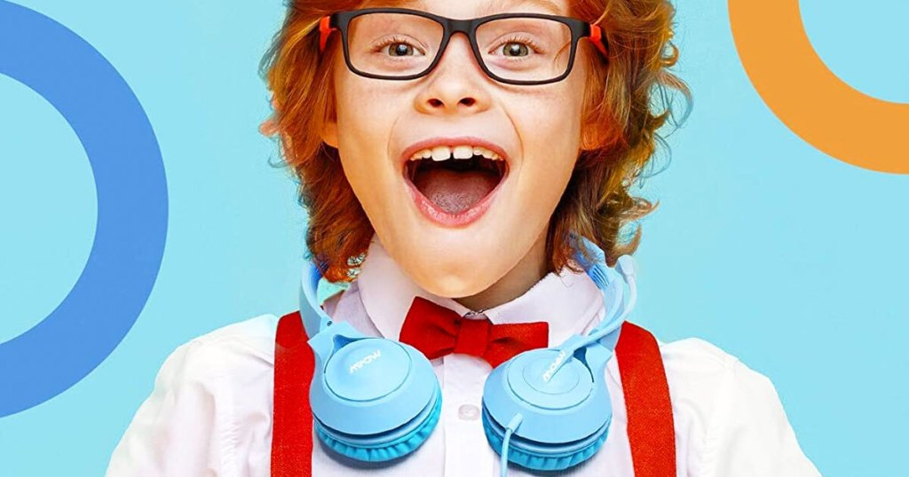 boy wearing blue headphones around his neck