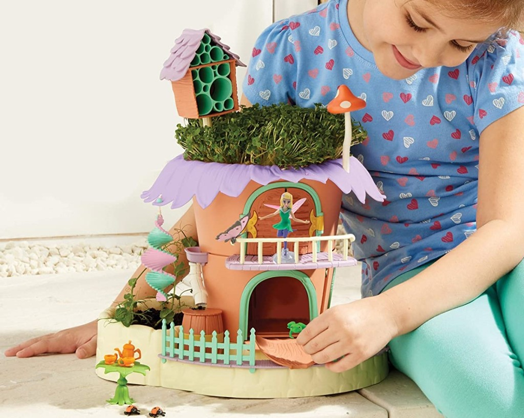 girl playing with a Fairy Garden set