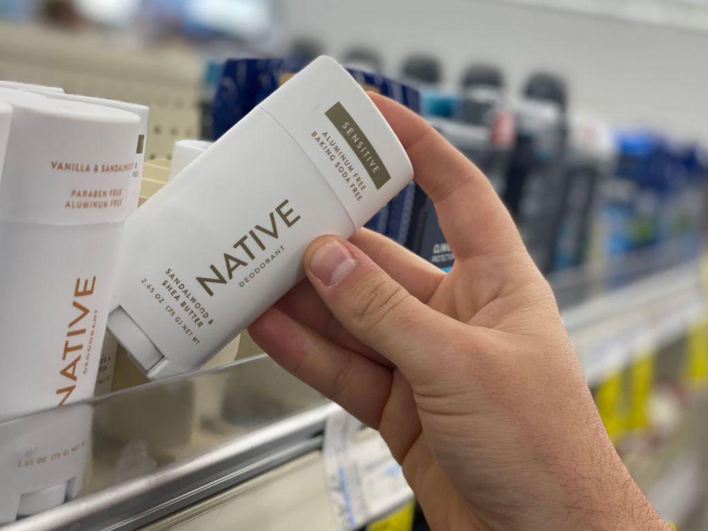 Man pulling Native Deodorant off a store shelf