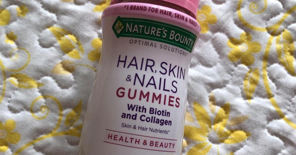 Bottle of gummy vitamins on quilt