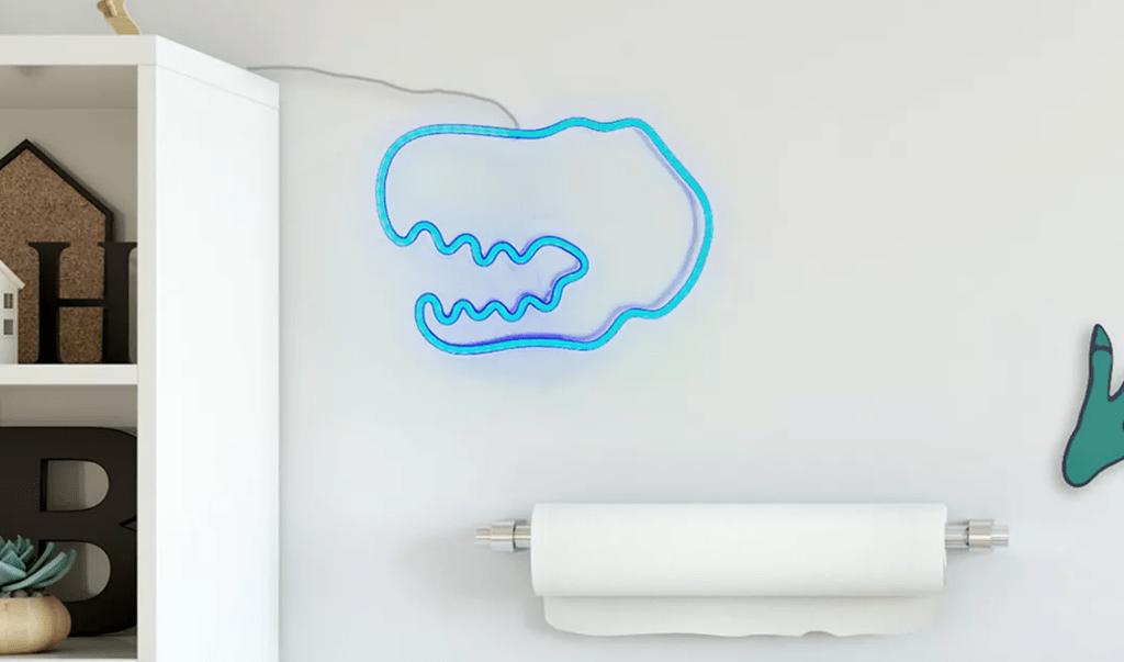 dinosaur light on a wall