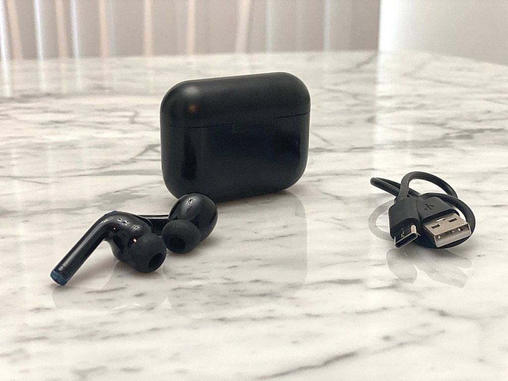 black earbuds charging case and cord