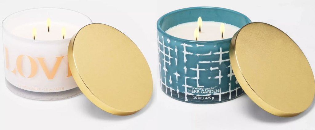 two lit 3 wick candles with gold lids