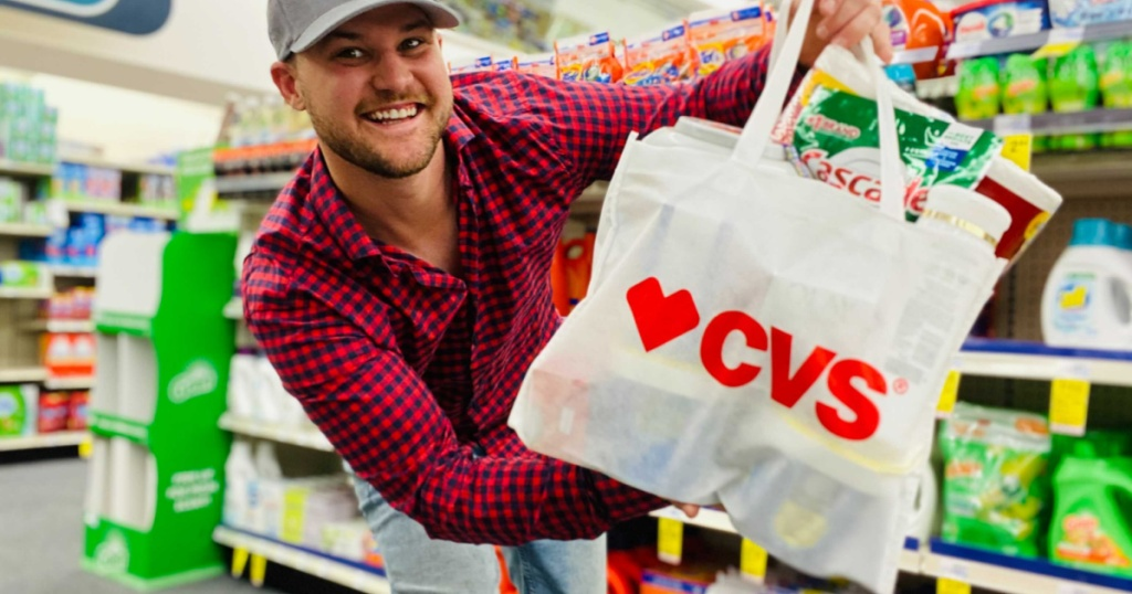 man holding CVS bag full of products