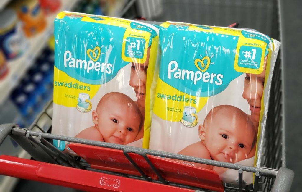 two bags of Pampers Swaddlers in a CVS cart
