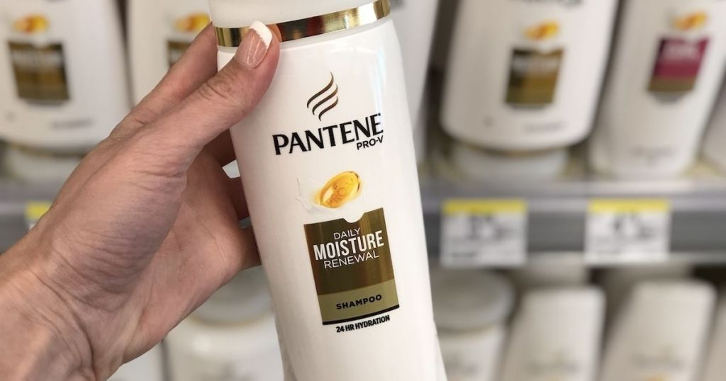 hand holding Pantene Shampoo in store