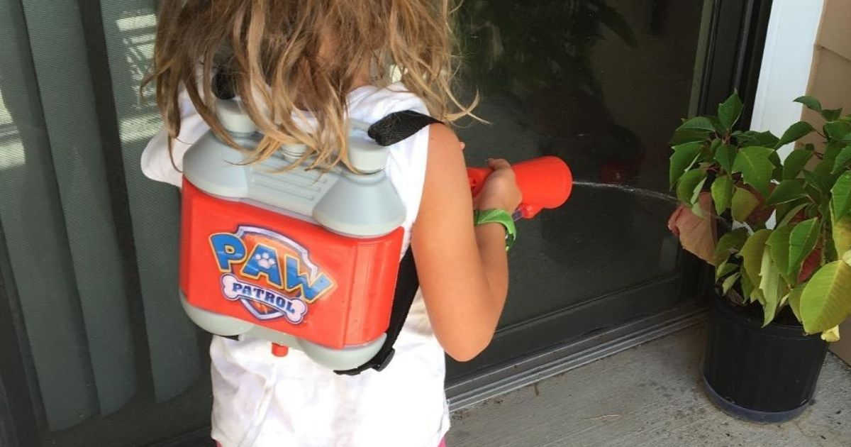 Little girl playing with Paw Patrol Water Rescue Backpack