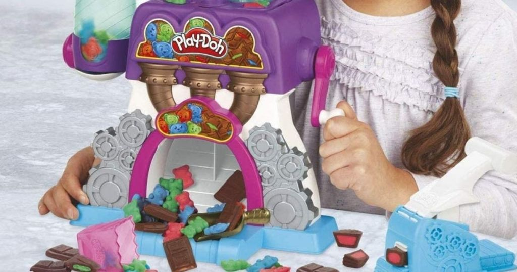 child playing with Play-Doh Kitchen Creations Candy Maker