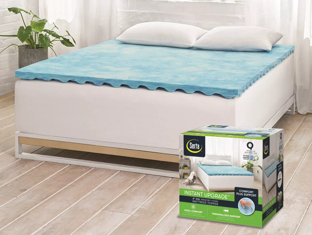 bed with a mattress topper on it