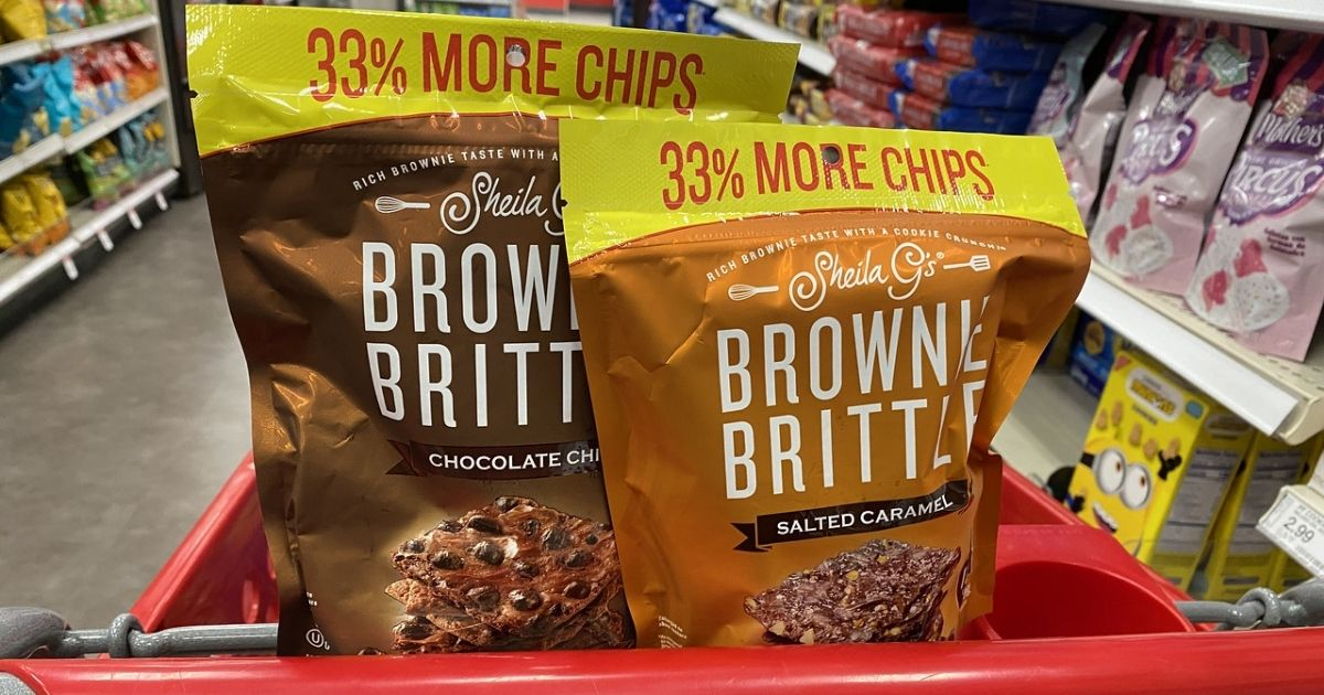 bags of brownie brittle in a target shopping cart in the middle of an aisle