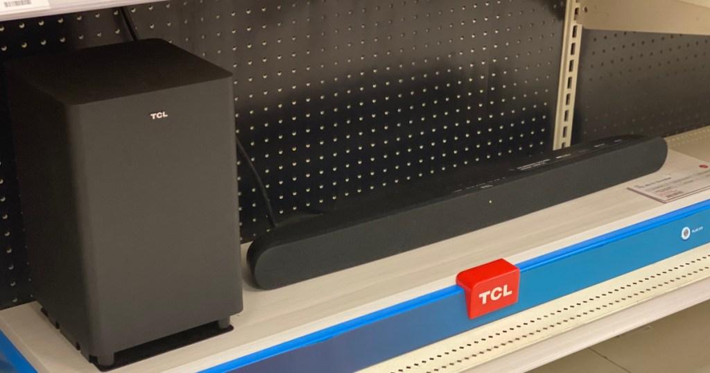 black soundbar and speaker on shelf