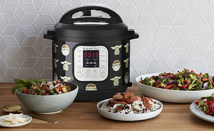 The Child Instant Pot next to plates of cooked dishes