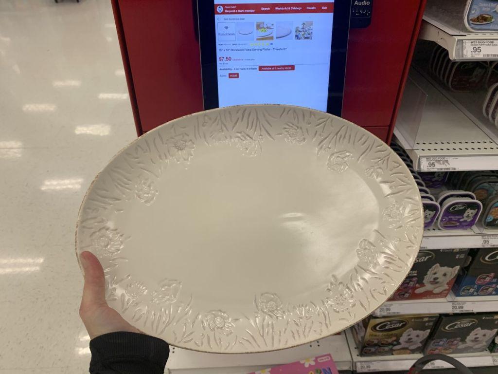 hand holding a platter