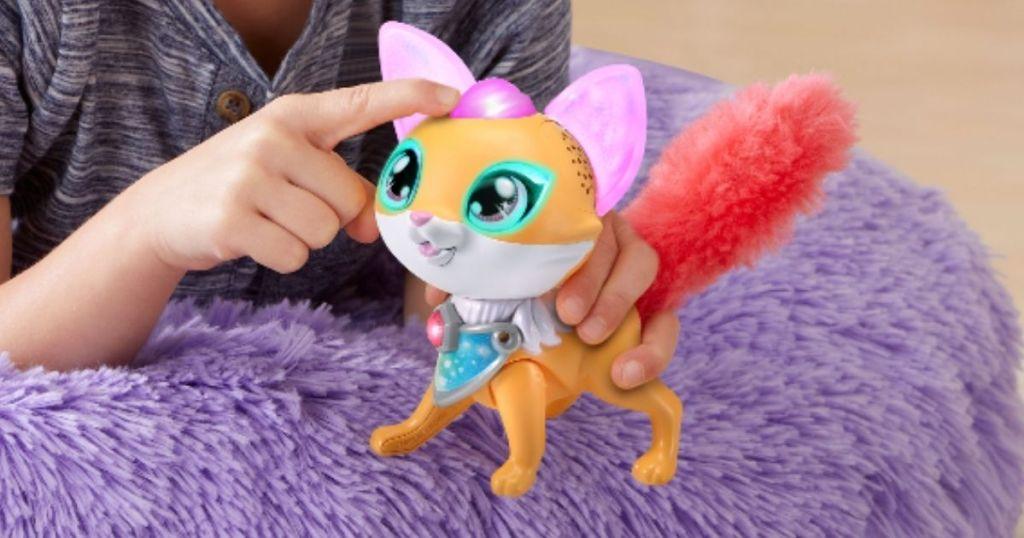 child on purple pillow with VTech Myla's Sparkling Friends Finn the Fox