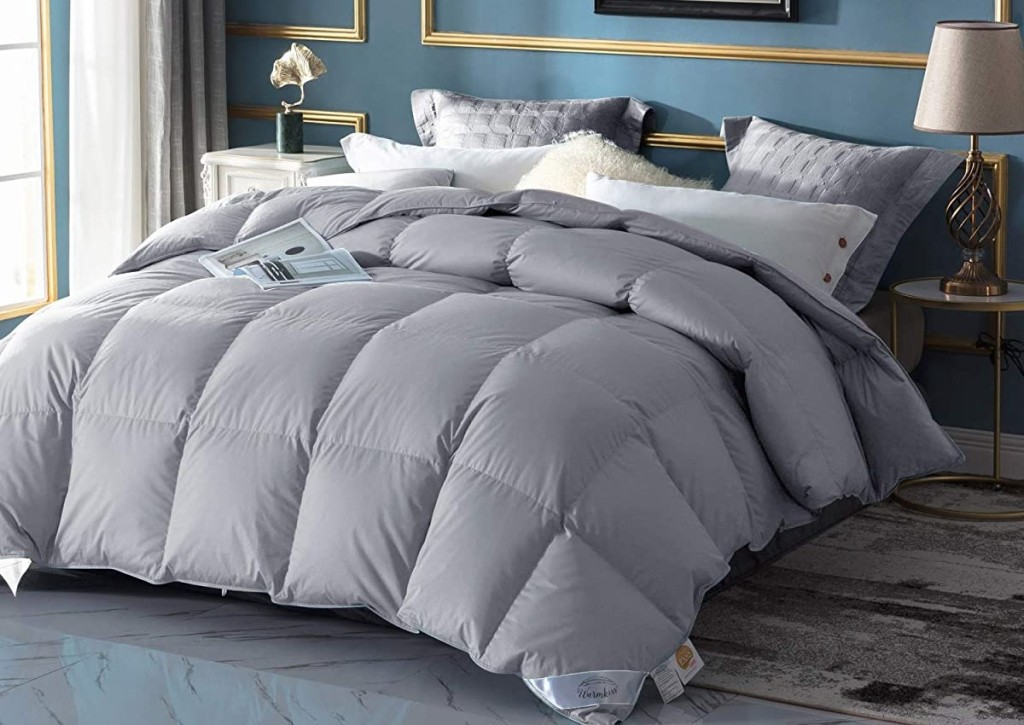 grey comforter on a bed