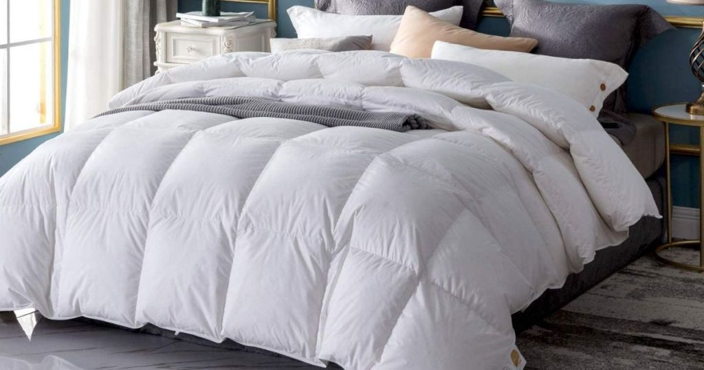 bed with a white comforter on it