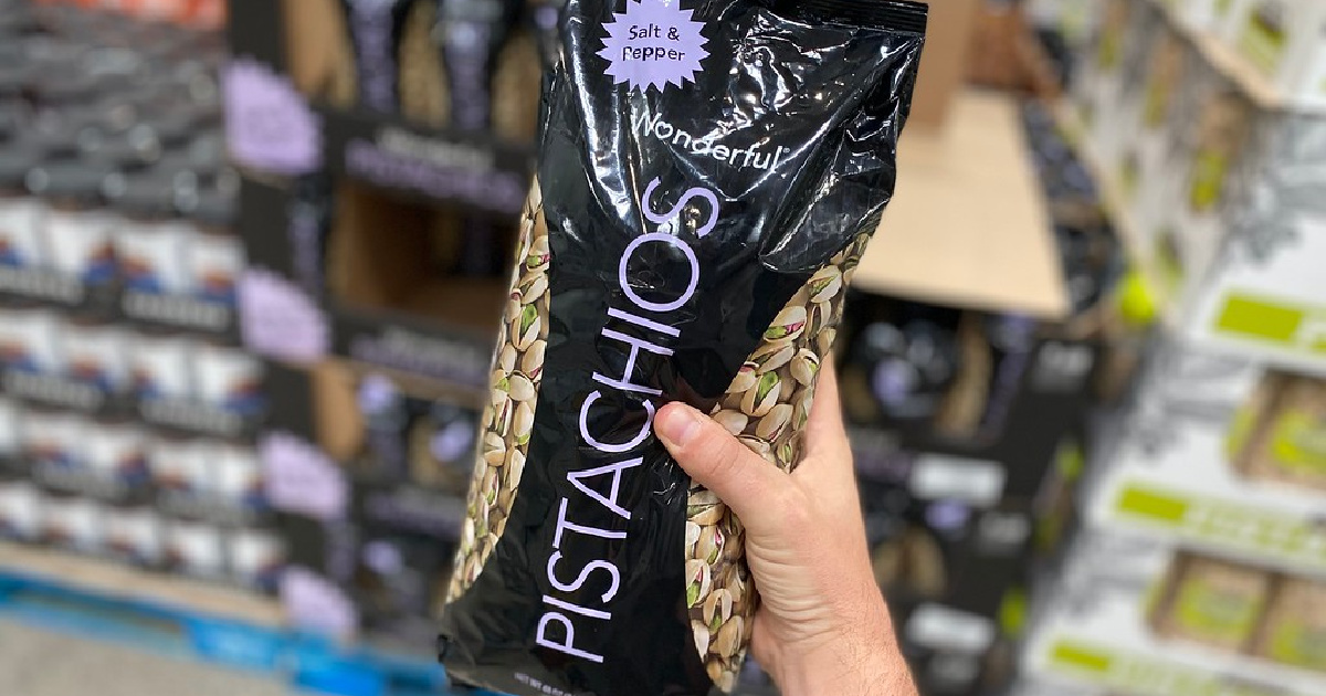 hand holding up a huge bag of pistachios in store