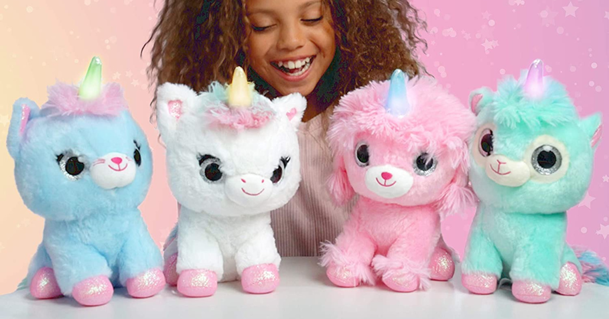 light up unicorns in a row in front of a girl
