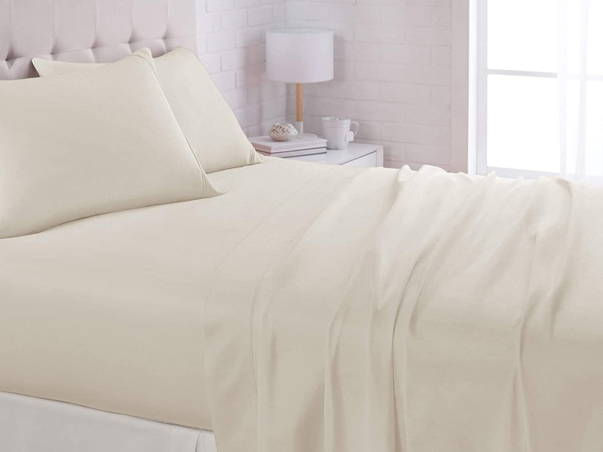 beige sheets on queen-sized bed