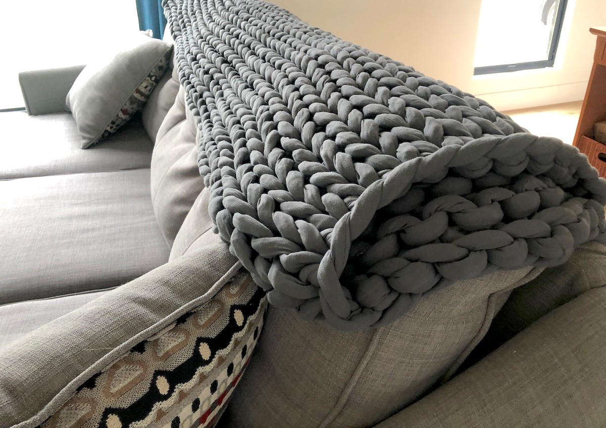 gray chunky knit blanket on back of couch