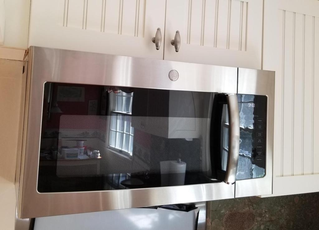 stainless steel microwave above stove top
