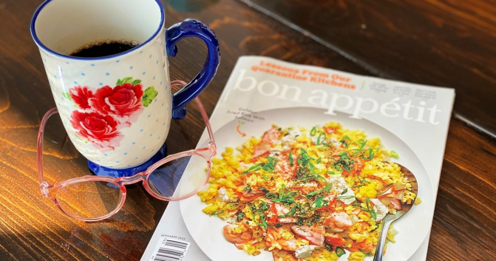 bon appetit magazine on table with cup and glasses
