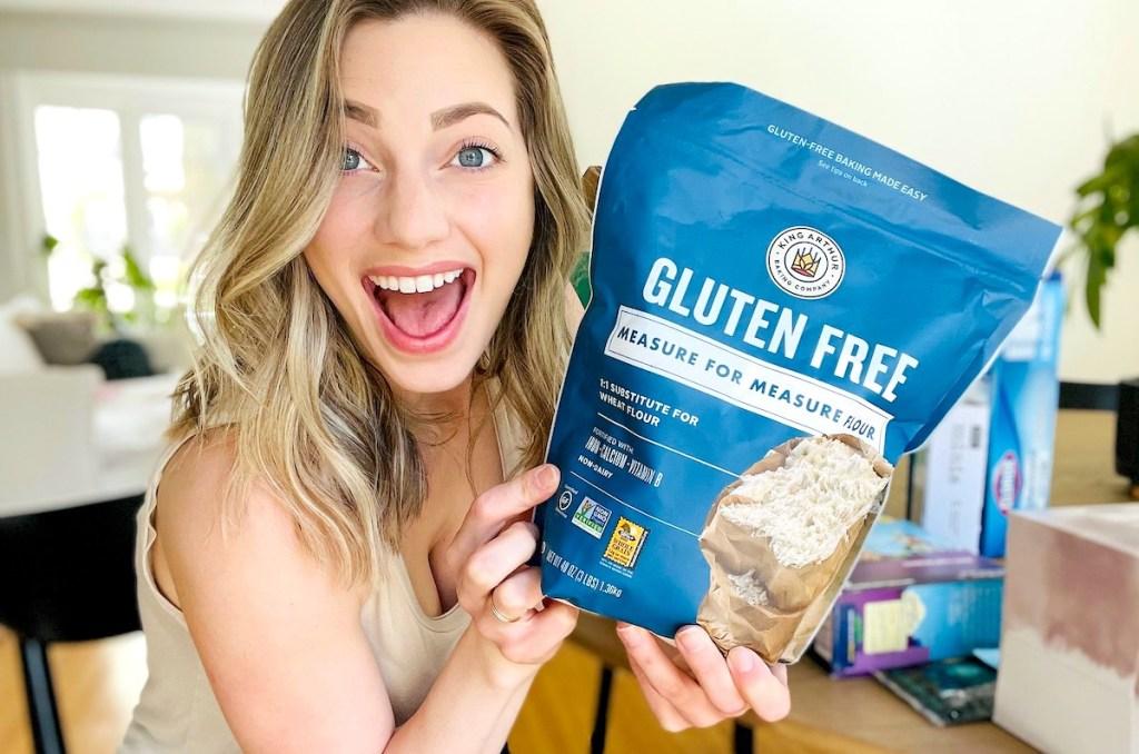 woman holding a bag of king arthur gluten free flour