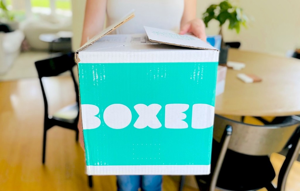 close up of woman holding boxed box in hands
