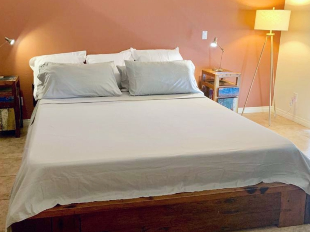 pale green sheets on king-size bed