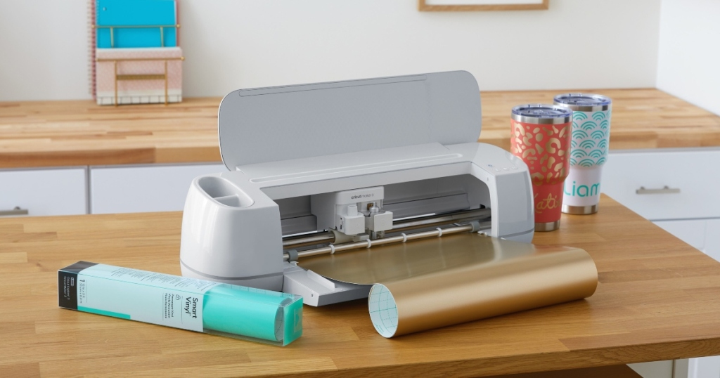 Cricut Maker 3 with tumblers and vinyl rolls