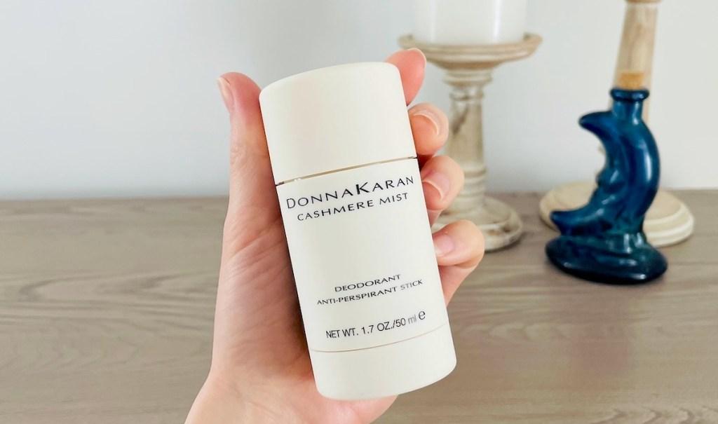 hand holding donna karan cashmere mist deodorant
