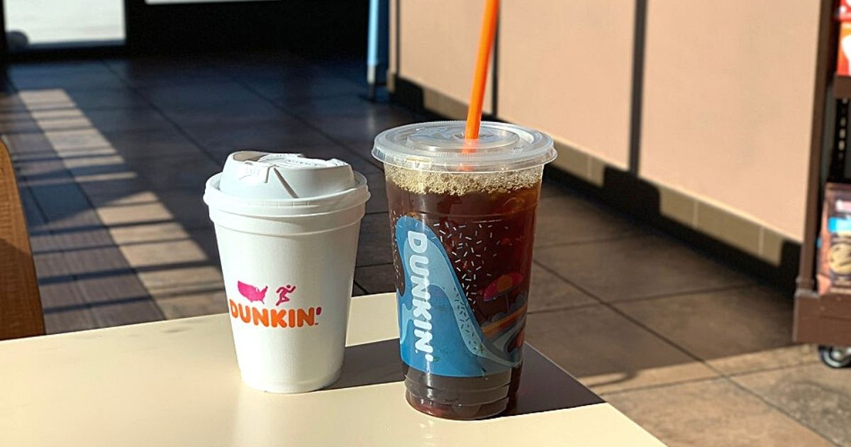 dunkin' hot coffee and iced coffee on table