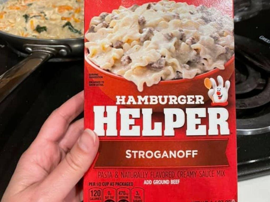 hand holding Hamburger helper