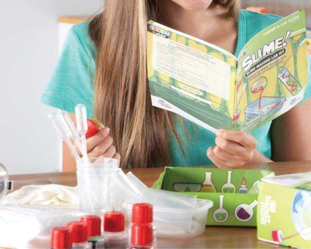 child playing with hand2mind slime making kit