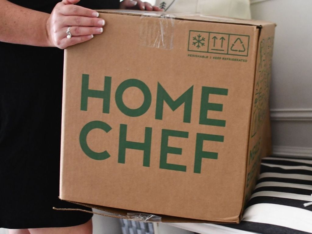 woman holding Home Chef box