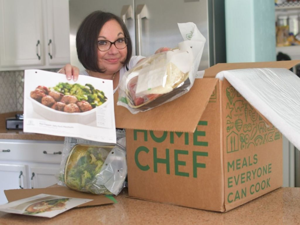 woman unloading home chef box