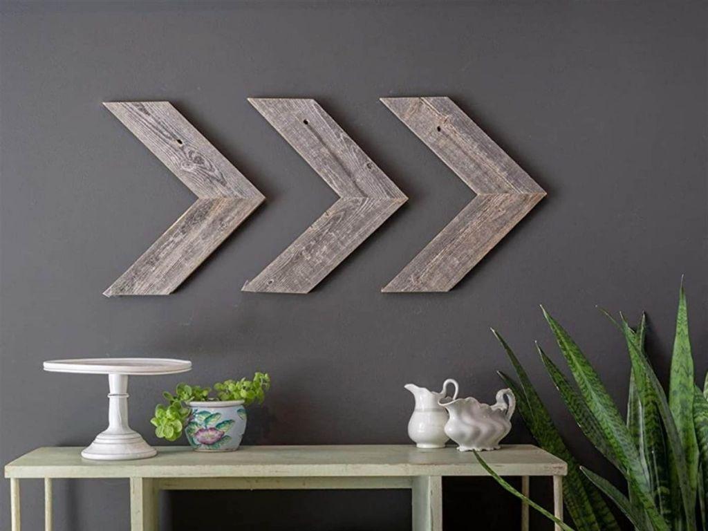 wooden arrow decor on wall