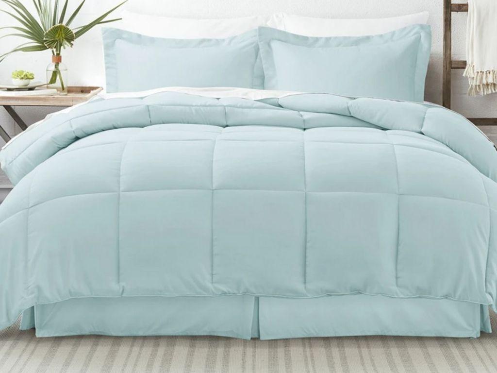 blue comforter set on bed