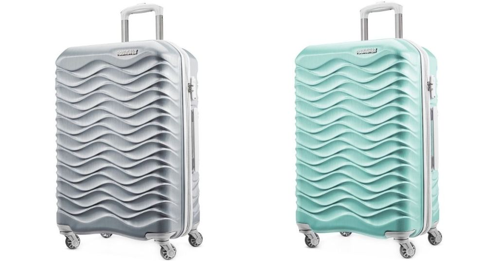 silver and teal luggage