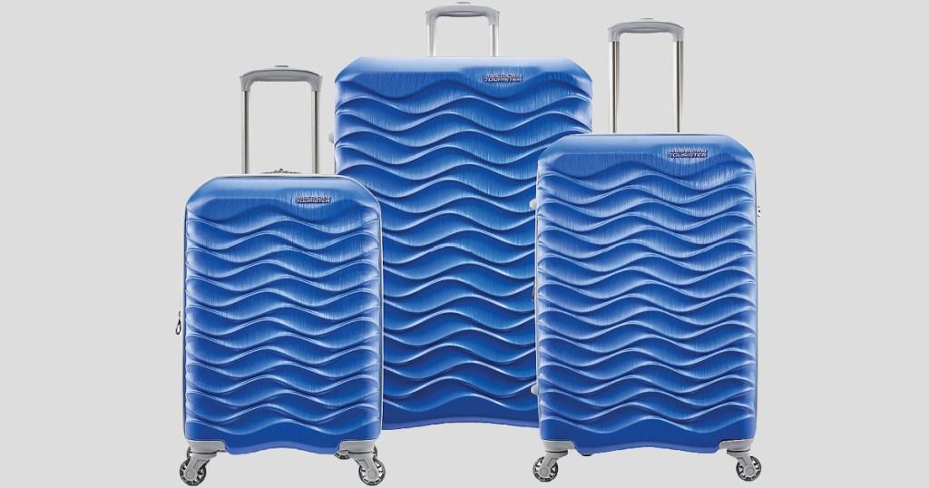 3 blue luggage on wheels