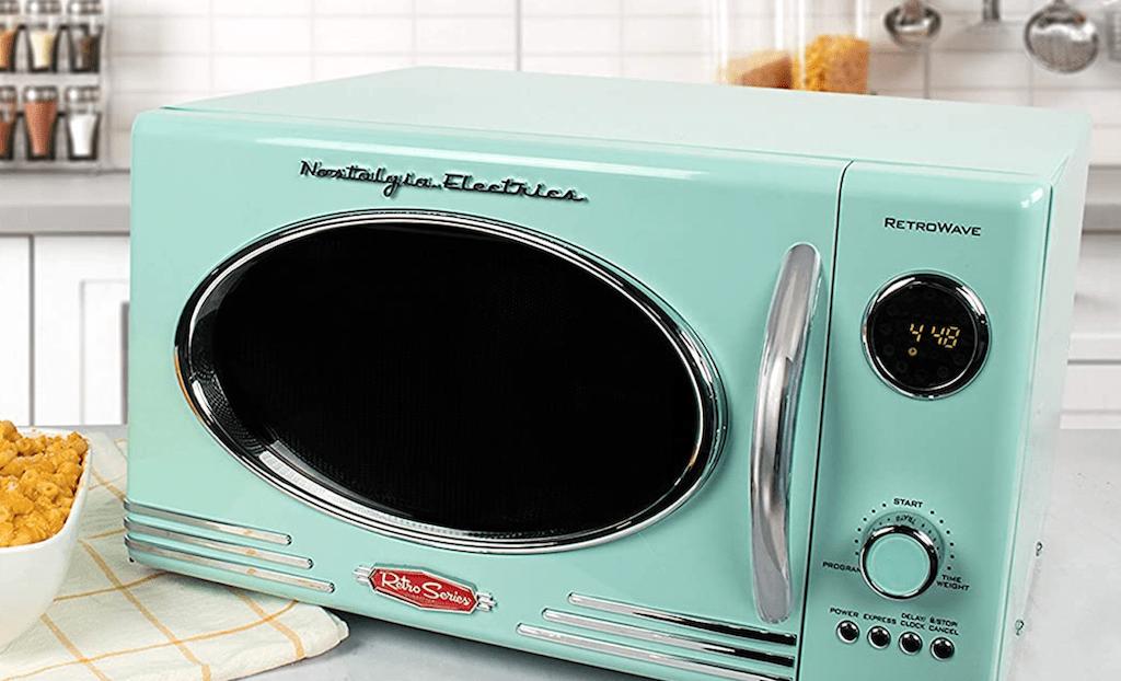 Nostalgia Electric retro microwave sitting on kitchen countertop