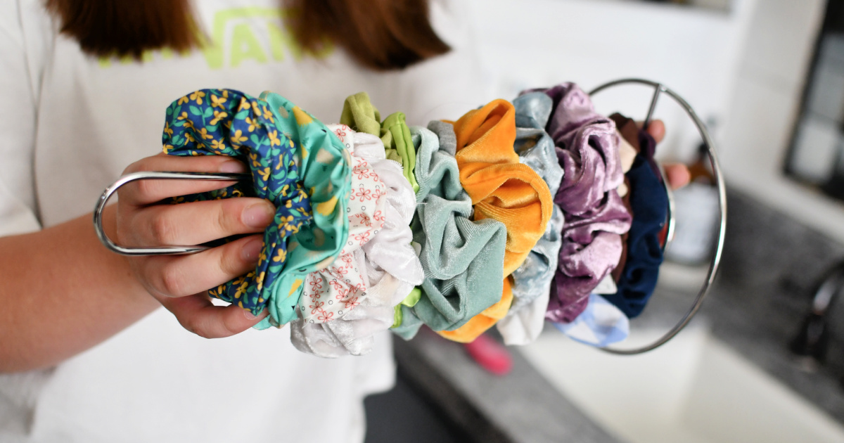 organizing scrunchies on a paper towel holder