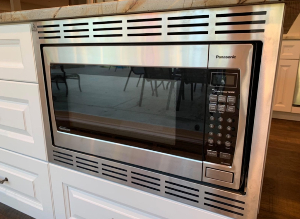 stainless steel microwave oven built into cabinets