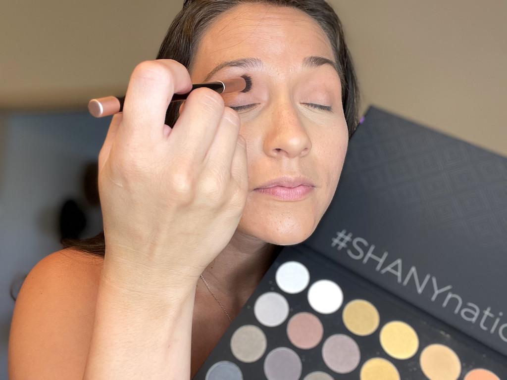 woman putting Shany eye shadow on